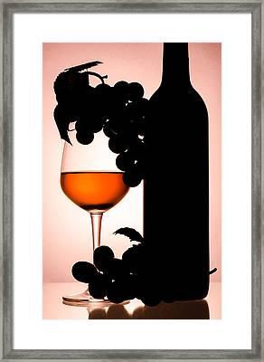 Bottle And Wine Glass Framed Print by Sirapol Siricharattakul