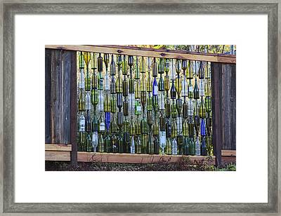 Bottle Fence Framed Print