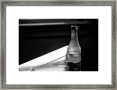Bottle Near Window Framed Print by Guillermo Hakim