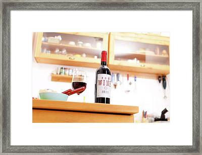 Bottle Of Red Wine On A Kitchen Table Framed Print
