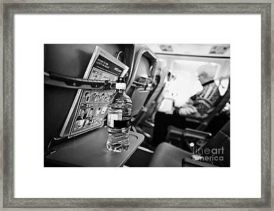 Bottle Of Water On Tray Table Interior Of Jet2 Aircraft Passenger Cabin In Flight Framed Print by Joe Fox