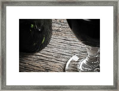 Bottle Of Wine And Glass Of Red Wine On Rustic Table Framed Print