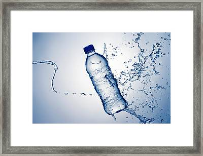 Bottle Water And Splash Framed Print by Johan Swanepoel