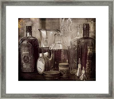 Bottles And Tins Framed Print
