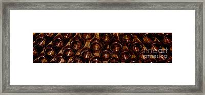 Bottles In The Cellar Framed Print by Jon Neidert