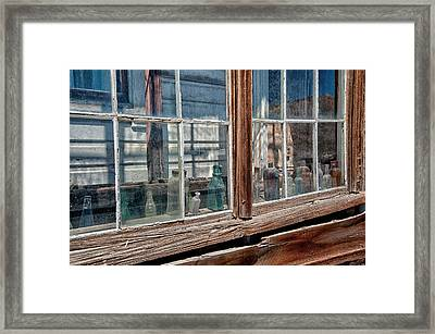 Bottles In The Window Framed Print by Cat Connor