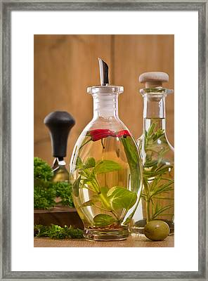 Bottles Of Olive Oil Framed Print by Amanda Elwell