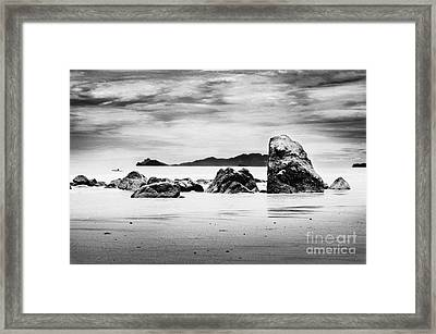 Boulders On The Beach Framed Print by William Voon