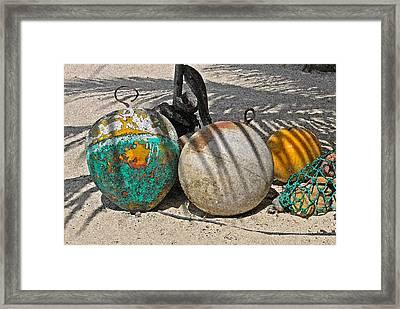 Bouys On The Beach Framed Print by Kurt Gustafson