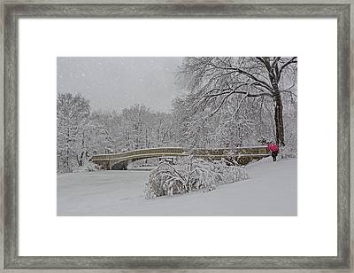 Bow Bridge In Central Park During Snowstorm Framed Print by Susan Candelario