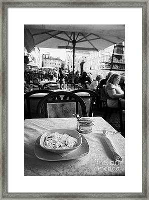 Bowl Of Spagetti Carbonara And Small Bowl Of Parmesan Cheese Sitting On A Table In A Street Cafe In The Piazza Navona Rome Lazio Italy Framed Print by Joe Fox