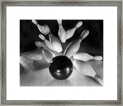 Bowling Ball Strikes Pins Framed Print by Underwood Archives