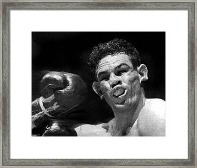 Boxer Catches A Left Hook Framed Print by Underwood Archives