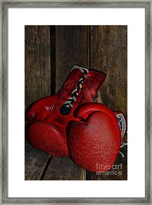 Boxing Gloves Worn Out Framed Print by Paul Ward