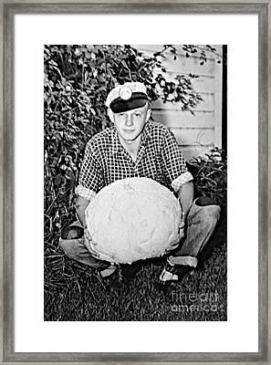 Boy And Puffball Framed Print