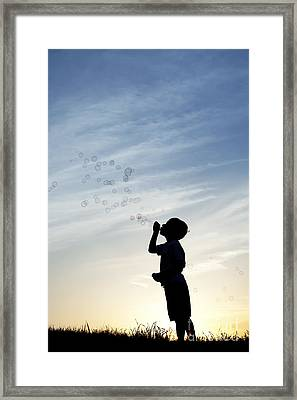 Boy Blowing Bubbles Framed Print