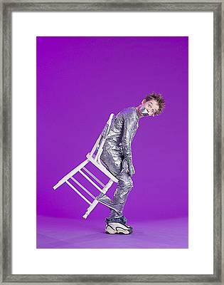 Boy Bound By Duct Tape Framed Print by Ron Nickel