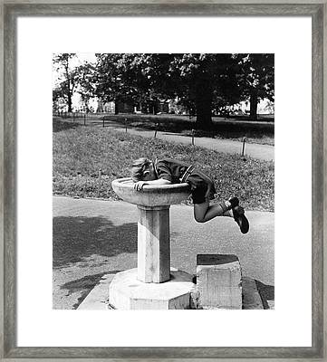 Boy Drinking From Fountain Framed Print