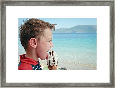 Boy Eating Ice Cream Framed Print by Tom Gowanlock