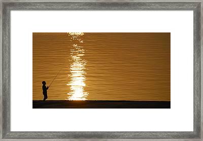 Boy Fishing At Sunset Framed Print