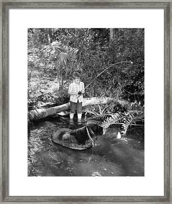 Boy Has A Unique Fishing Partner Framed Print by Retro Images Archive