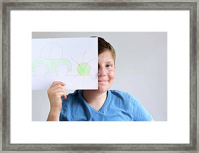 Boy Holding Drawing Of Car And Sun Framed Print by Gombert, Sigrid