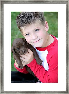 Boy Holding Puppy Framed Print by Colleen Cahill