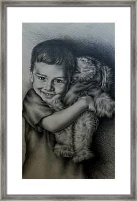 Boy Hugging Teddy Framed Print by Lisa Marie Szkolnik