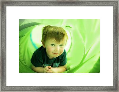 Boy In Green Tunnel Framed Print by Samuel Ashfield