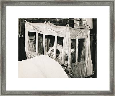 Boy In Oxygen Tent Framed Print by Underwood Archives