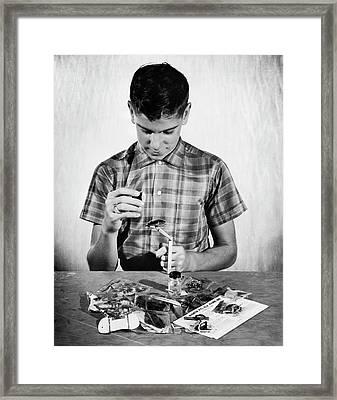 Boy Learning To Tie Flies Framed Print