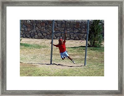 Boy On Swing Framed Print by Mark Goebel