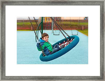 Boy On Swing Framed Print by Tom Gowanlock