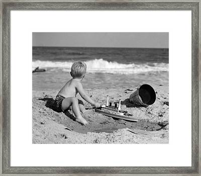 Boy Playing At The Beach, C.1950s Framed Print
