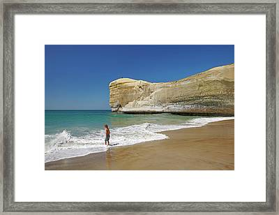 Boy Playing At Tunnel Beach, Dunedin Framed Print by David Wall
