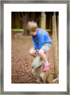Boy Playing In The Park Framed Print