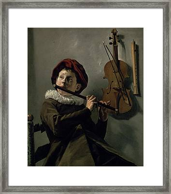 Boy Playing The Flute Framed Print
