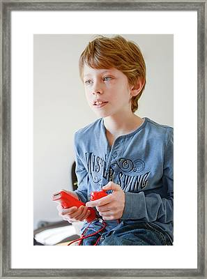 Boy Playing Wii Video Game Framed Print by Aj Photo