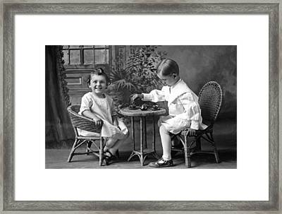 Boy Pours Sister A Cup Of Tea Framed Print
