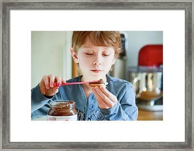 Boy Preparing His Breakfast Framed Print