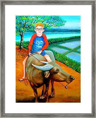 Boy Riding A Carabao Framed Print