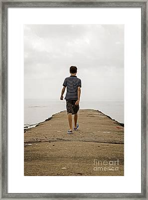 Boy Walking On Concrete Beach Pier Framed Print by Edward Fielding