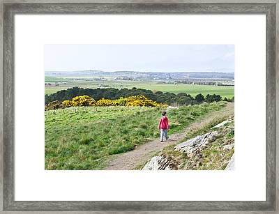 Boy Walking Framed Print by Tom Gowanlock
