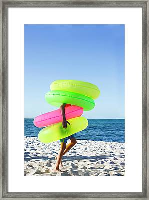 Boy Wearing Lots Of Rubber Rings Framed Print by Gary John Norman