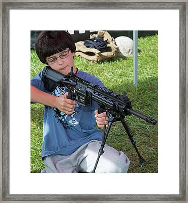 Boy With Automatic Rifle Framed Print by Jim West