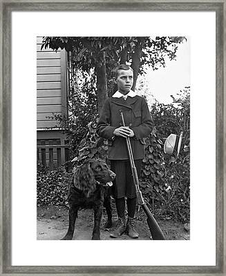 Boy With His Rifle And Dog Framed Print by Underwood Archives