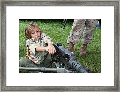 Boy With Machine Gun Framed Print by Jim West
