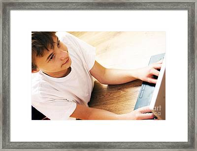 Boy With Notebook Framed Print by Michal Bednarek