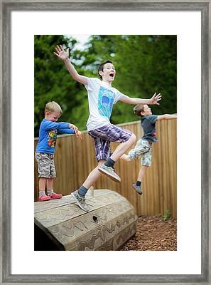 Boys Playing In Park Framed Print