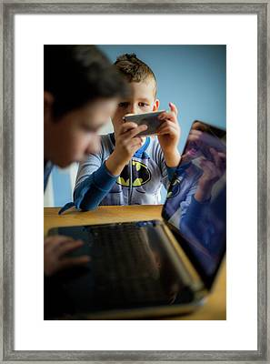 Boys Using Smartphone And Laptop Framed Print by Samuel Ashfield